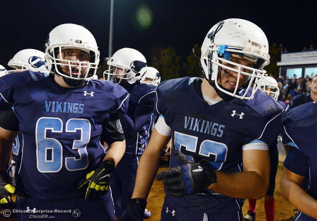 Description of . Pleasant Valley Highs\' #63 Harrison Carter (left) and #52 Riley Andrew (right) against Shasta High in the fourth quarter of their football game at PVHS Asgard Yard Friday, October 18, 2013 in Chico, Calif.  (Jason Halley/Chico Enterprise-Record)
