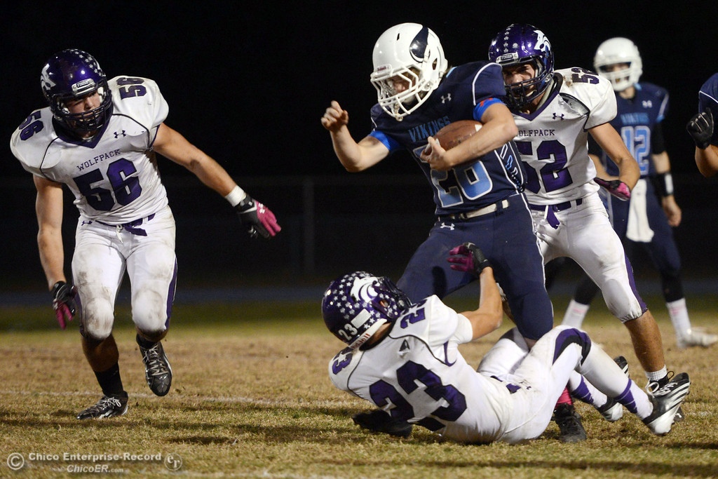 Description of . Pleasant Valley High\'s #28 Dylan Batie (center) rushes against Shasta High\'s #23 Ryan Pallato (bottom) #56 Nic Ariagno (left) and #52 Jake Thengvall (right) in the second quarter of their football game at PVHS Asgard Yard Friday, October 18, 2013 in Chico, Calif.  (Jason Halley/Chico Enterprise-Record)