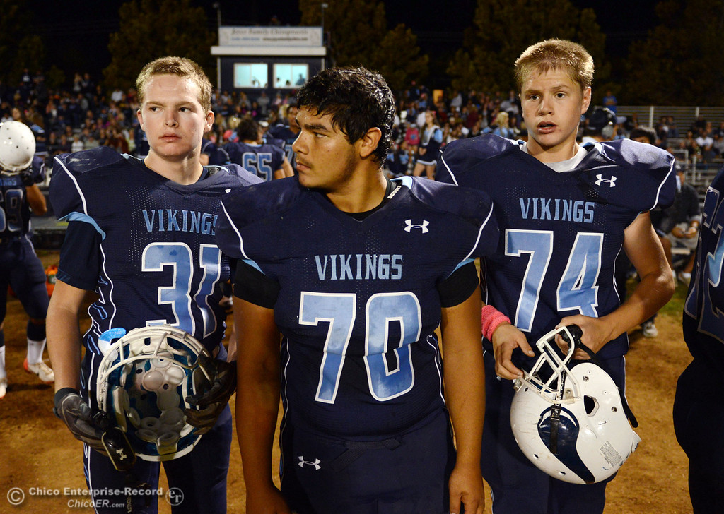 Description of . Pleasant Valley High\'s #31 Cody Tavenner, #70 Josh Alvarez and #74 Izaak Farley (left to right) against Shasta High in the first quarter of their football game at PVHS Asgard Yard Friday, October 18, 2013 in Chico, Calif.  (Jason Halley/Chico Enterprise-Record)