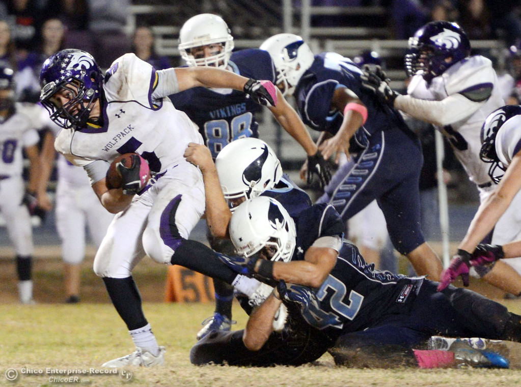 Description of . Pleasant Valley High\'s #42 Chad Olsen (bottom) tackles against Shasta High\'s #5 Jake Callaway (left) in the fourth quarter of their football game at PVHS Asgard Yard Friday, October 18, 2013 in Chico, Calif.  (Jason Halley/Chico Enterprise-Record)