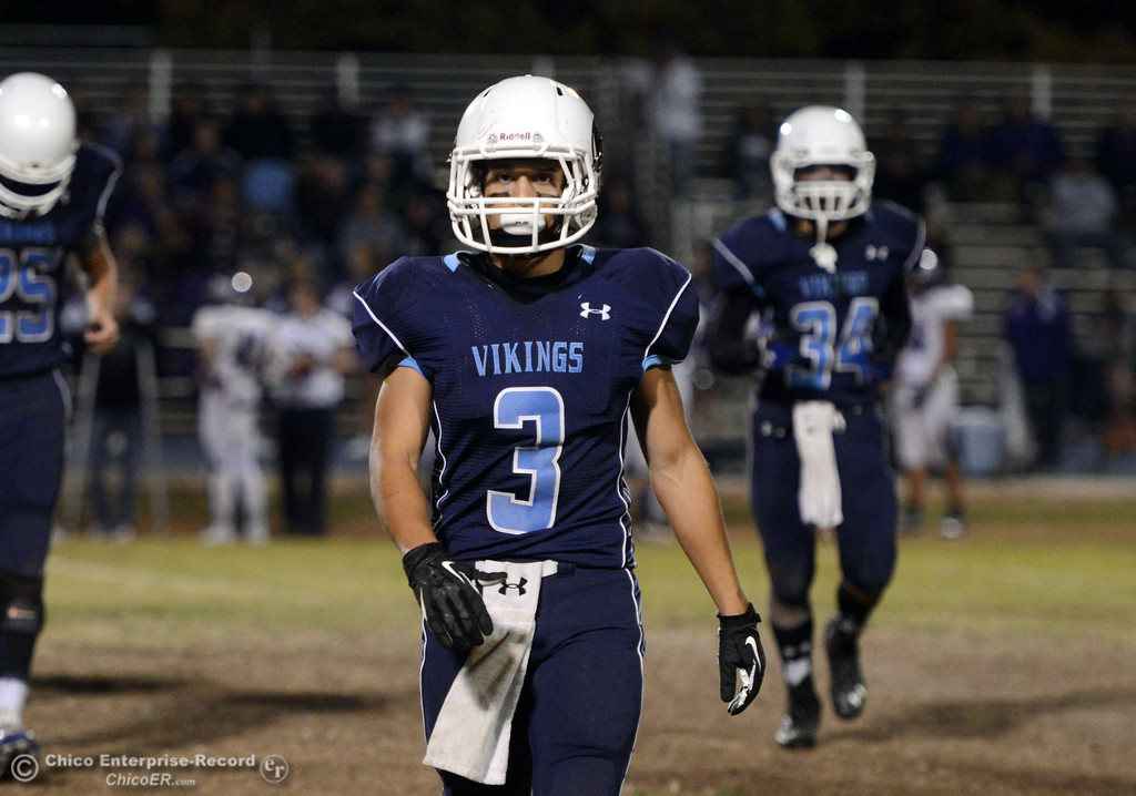 Description of . Pleasant Valley High\'s #3 Brandon Romero against Shasta High in the second quarter of their football game at PVHS Asgard Yard Friday, October 18, 2013 in Chico, Calif.  (Jason Halley/Chico Enterprise-Record)