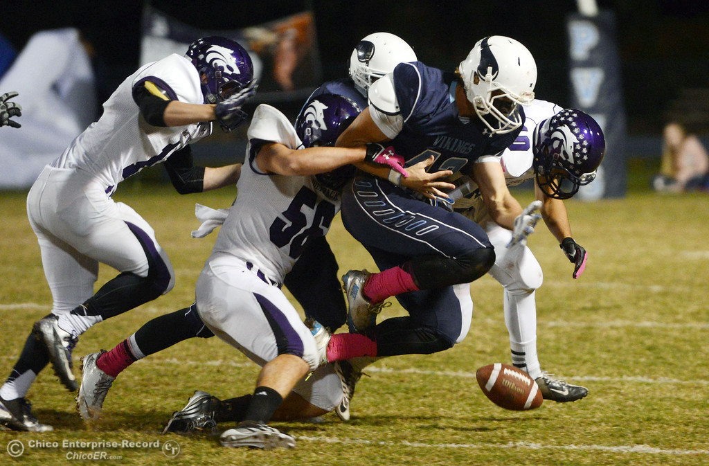 Description of . Pleasant Valley High\'s #42 Chad Olsen (center) fumbles the ball  against Shasta High in the first quarter of their football game at PVHS Asgard Yard Friday, October 18, 2013 in Chico, Calif.  (Jason Halley/Chico Enterprise-Record)