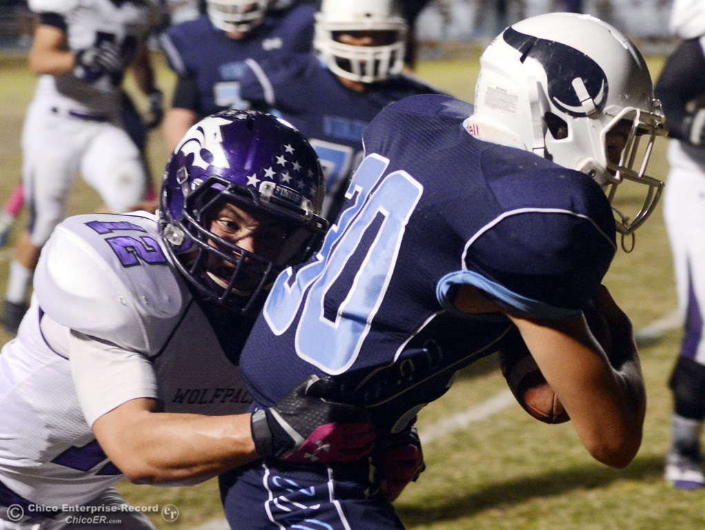Description of . Pleasant Valley High\'s #30 Connor Melton (right) is tackled against Shasta High\'s #52 Jake Thengvall (left) in the first quarter of their football game at PVHS Asgard Yard Friday, October 18, 2013 in Chico, Calif.  (Jason Halley/Chico Enterprise-Record)