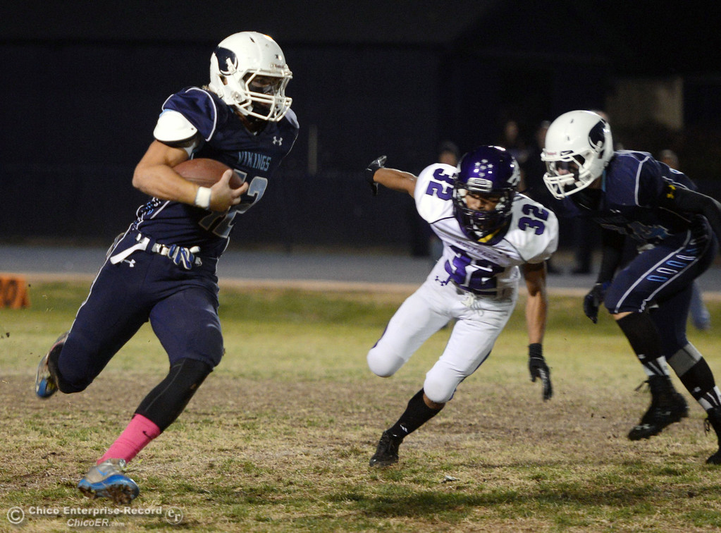 Description of . Pleasant Valley High\'s #42 Chad Olsen (left) rushes against Shasta High\'s #32 Trevon Lewis (right) with PV\'s #34 Cale Crawford (right) in the first quarter of their football game at PVHS Asgard Yard Friday, October 18, 2013 in Chico, Calif.  (Jason Halley/Chico Enterprise-Record)