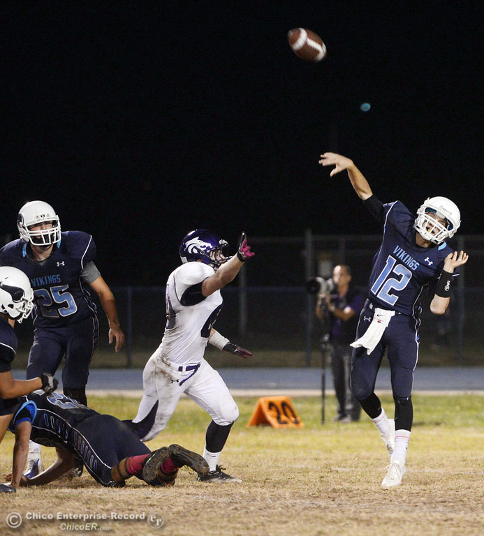 Description of . Pleasant Valley High\'s #12 Trent Darms throws a deep pass against Shasta High in the second quarter of their football game at PVHS Asgard Yard Friday, October 18, 2013 in Chico, Calif.  (Jason Halley/Chico Enterprise-Record)