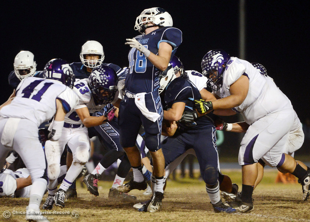 Description of . Pleasant Valley High\'s #48 Logan O\'Sullivan (center) is hit in the back by #28 Dylan Batie on a carry against Shasta High in the second quarter of their football game at PVHS Asgard Yard Friday, October 18, 2013 in Chico, Calif.  (Jason Halley/Chico Enterprise-Record)