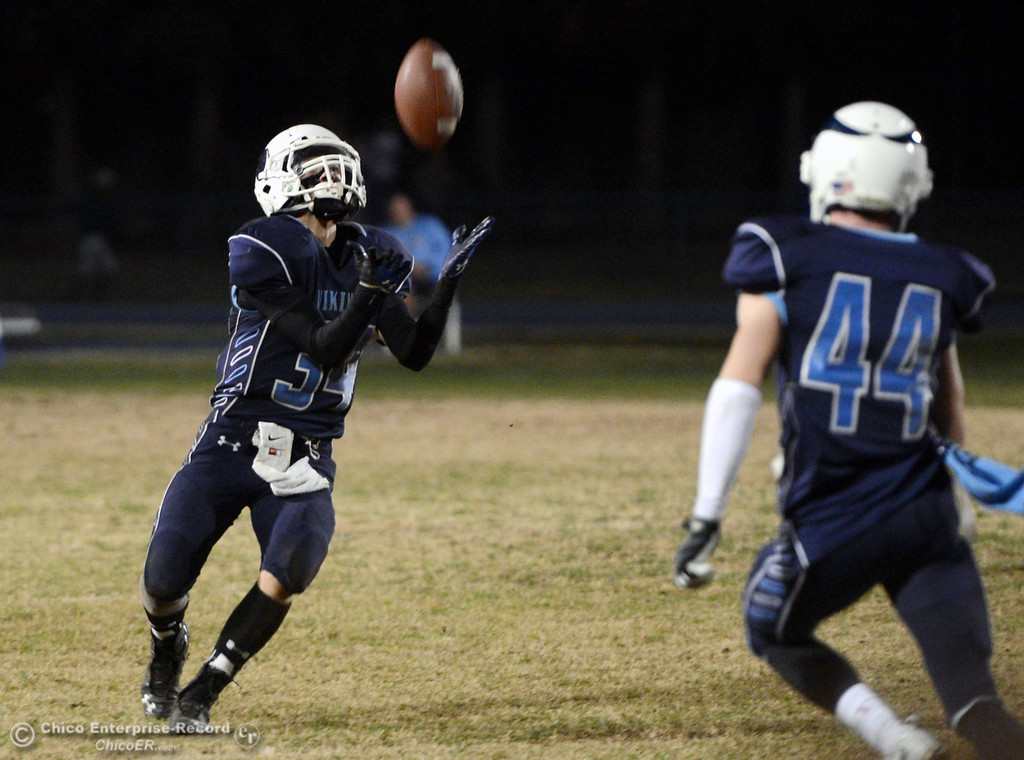 Description of . Pleasant Valley High\'s #34 Cale Crawford catches a punt return against Shasta High in the fourth quarter of their football game at PVHS Asgard Yard Friday, October 18, 2013 in Chico, Calif.  (Jason Halley/Chico Enterprise-Record)