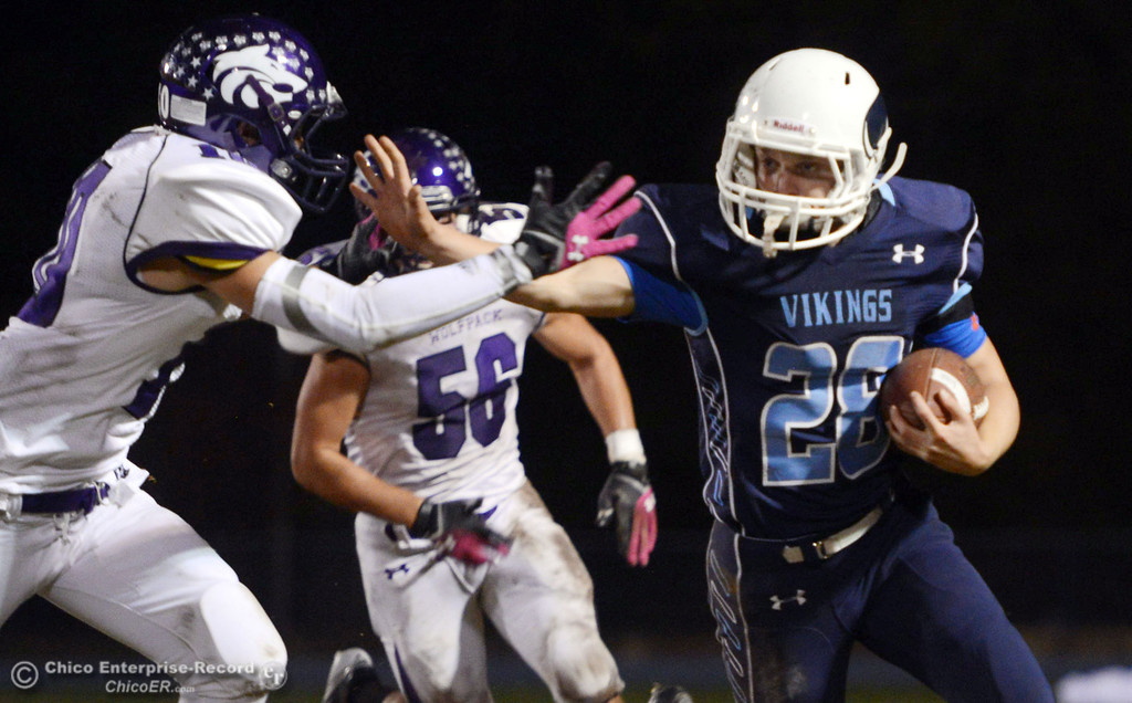 Description of . Pleasant Valley High\'s #28 Dylan Batie (right) rushes against Shasta High\'s #10 Noah Ferguson (left) in the second quarter of their football game at PVHS Asgard Yard Friday, October 18, 2013 in Chico, Calif.  (Jason Halley/Chico Enterprise-Record)