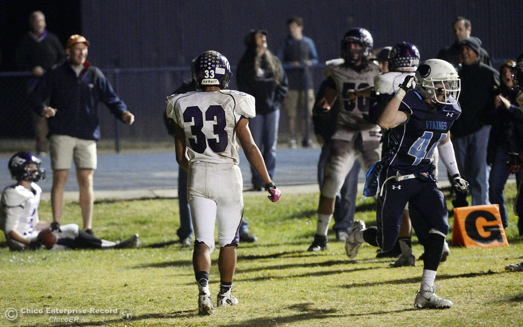 Description of . Pleasant Valley High\'s #44 Cyland Leitner (right) reacts to Shasta High unable to score a 2 pt conversion to tie the game in the fourth quarter of their football game at PVHS Asgard Yard Friday, October 18, 2013 in Chico, Calif.  (Jason Halley/Chico Enterprise-Record)