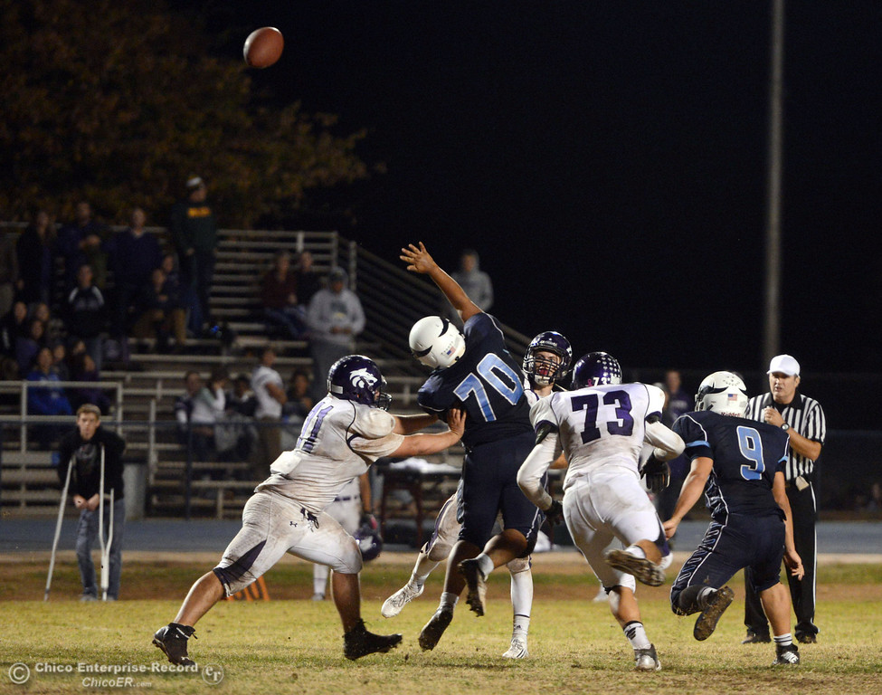 Description of . Pleasant Valley High against Shasta High in the fourth quarter of their football game at PVHS Asgard Yard Friday, October 18, 2013 in Chico, Calif.  (Jason Halley/Chico Enterprise-Record)