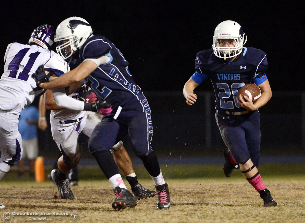 Description of . Pleasant Valley High\'s #28 Dylan Batie (right) rushes against Shasta High in the second quarter of their football game at PVHS Asgard Yard Friday, October 18, 2013 in Chico, Calif.  (Jason Halley/Chico Enterprise-Record)