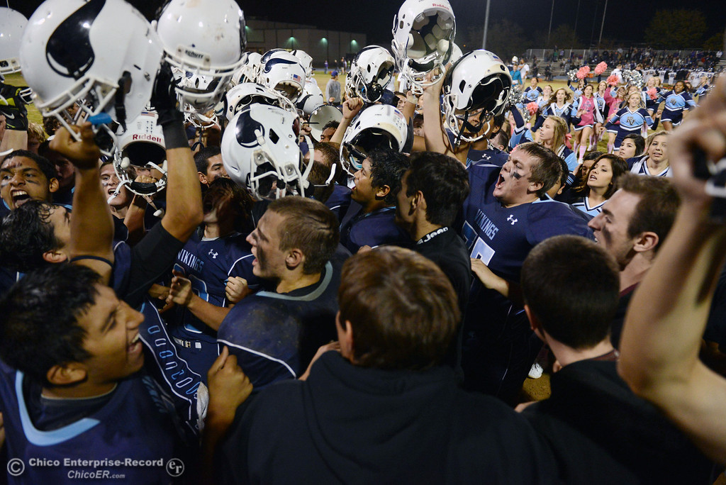Description of . Pleasant Valley High celebrates their win against Shasta High at the end of the fourth quarter of their football game at PVHS Asgard Yard Friday, October 18, 2013 in Chico, Calif.  (Jason Halley/Chico Enterprise-Record)