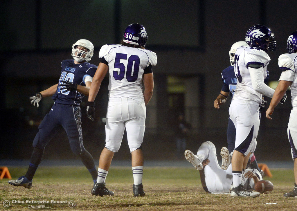 Description of . Pleasant Valley High\'s #88 Zack Suttles (left) reacts to making a tackle against Shasta High in the second quarter of their football game at PVHS Asgard Yard Friday, October 18, 2013 in Chico, Calif.  (Jason Halley/Chico Enterprise-Record)