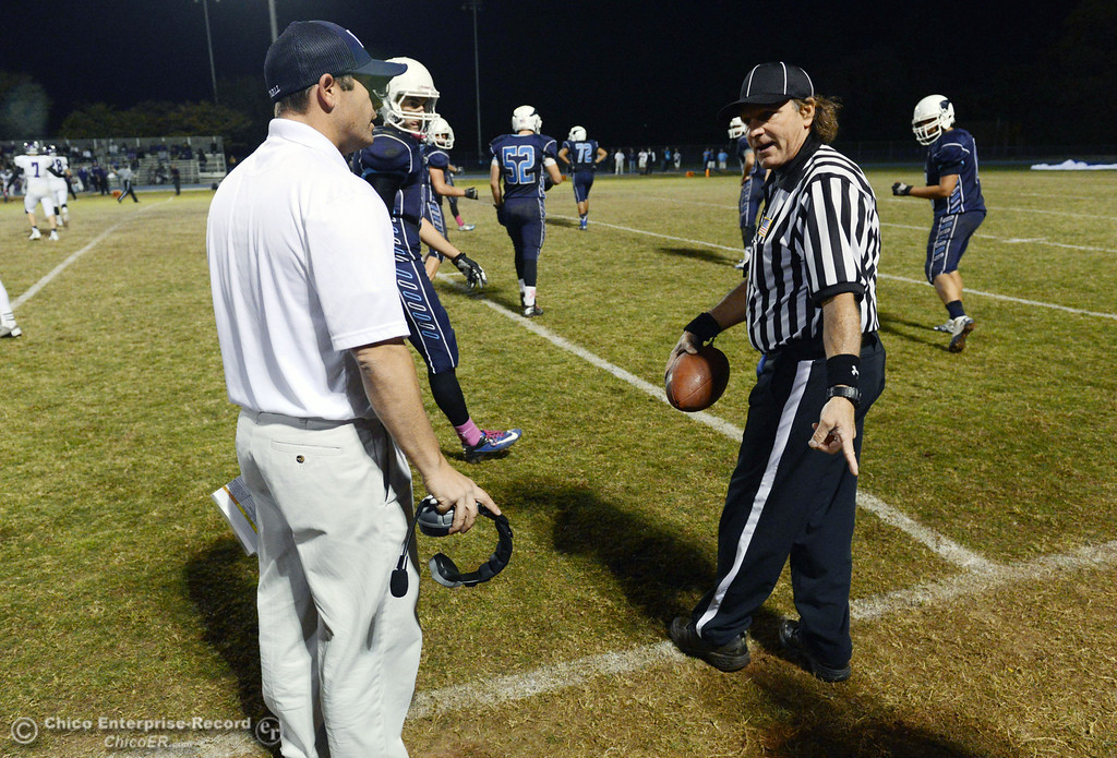 Description of . Pleasant Valley High coach Mark Cooley argues a call to the ref about a late hit that wasn\'t called against Shasta High in the second quarter of their football game at PVHS Asgard Yard Friday, October 18, 2013 in Chico, Calif.  (Jason Halley/Chico Enterprise-Record)