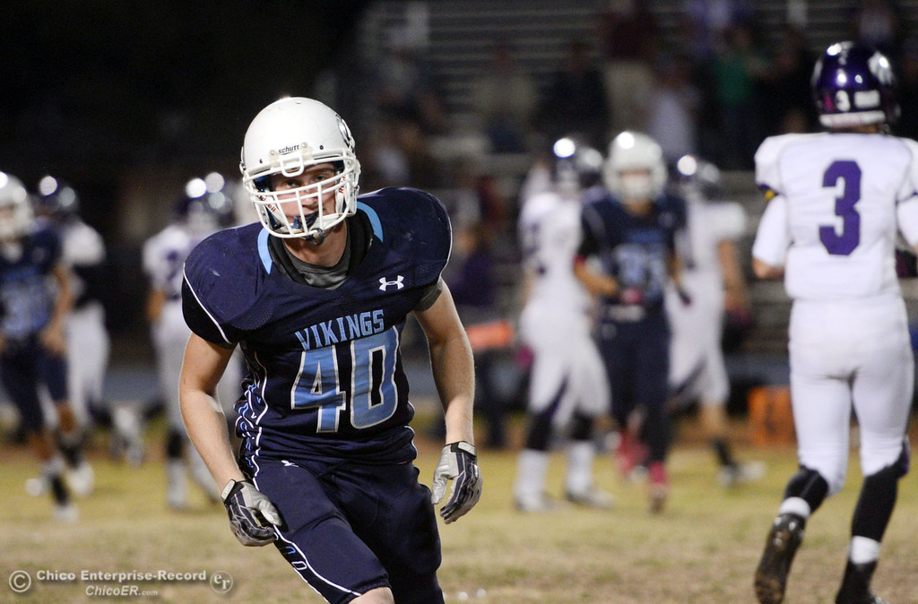 Description of . Pleasant Valley High\'s #40 Stacy Stephens against Shasta High in the first quarter of their football game at PVHS Asgard Yard Friday, October 18, 2013 in Chico, Calif.  (Jason Halley/Chico Enterprise-Record)