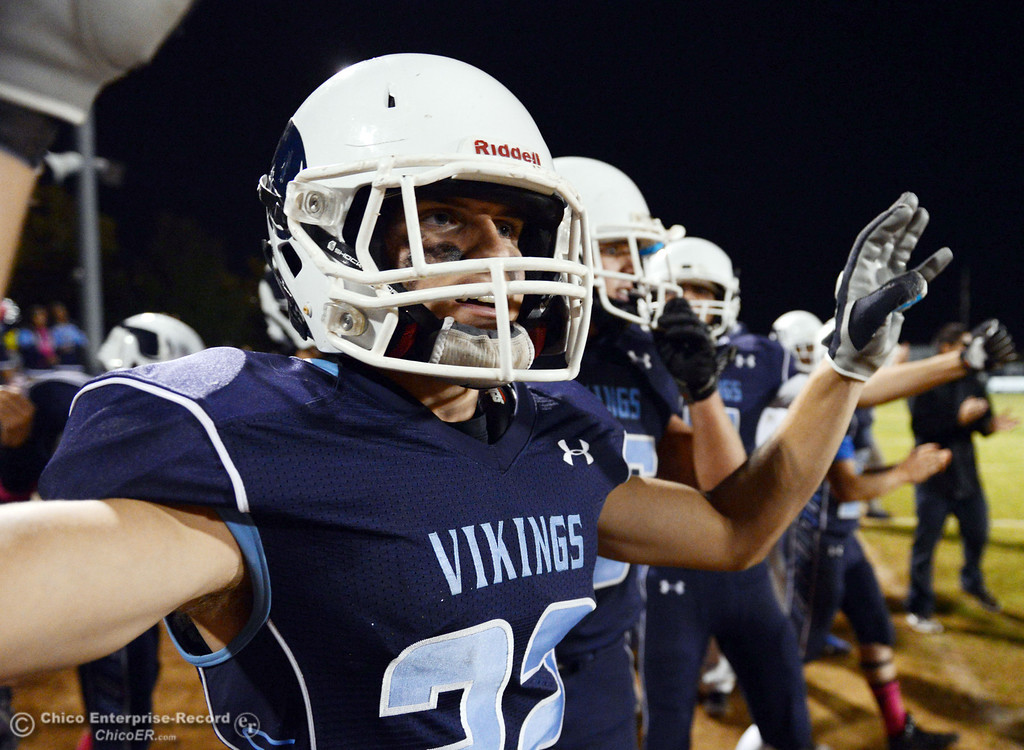Description of . Pleasant Valley High\'s #22 Jake Dani celebrates their win against Shasta High in the fourth quarter of their football game at PVHS Asgard Yard Friday, October 18, 2013 in Chico, Calif.  (Jason Halley/Chico Enterprise-Record)