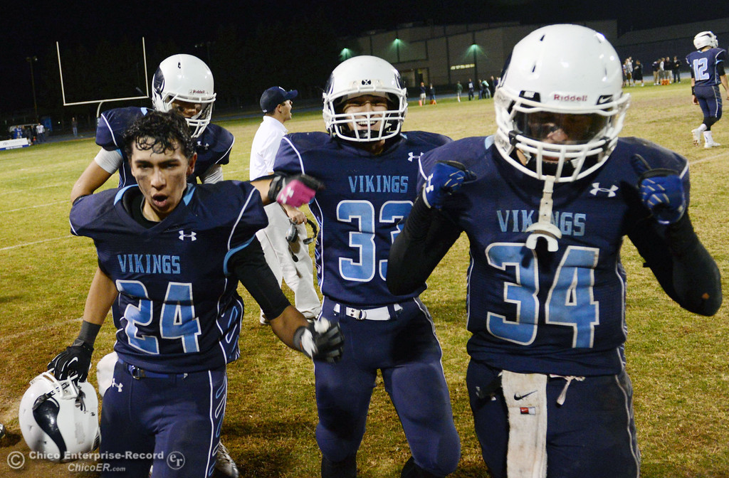 Description of . Pleasant Valley High\'s #24  Jack Soza, #33 Taylor Wright, and #34 Cale Crawford (left to right) celebrate their win against Shasta High in the fourth quarter of their football game at PVHS Asgard Yard Friday, October 18, 2013 in Chico, Calif.  (Jason Halley/Chico Enterprise-Record)