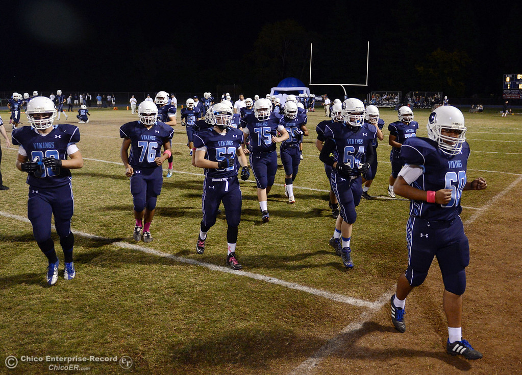 Description of . Pleasant Valley High takes the field against Shasta High before the first quarter of their football game at PVHS Asgard Yard Friday, October 18, 2013 in Chico, Calif.  (Jason Halley/Chico Enterprise-Record)