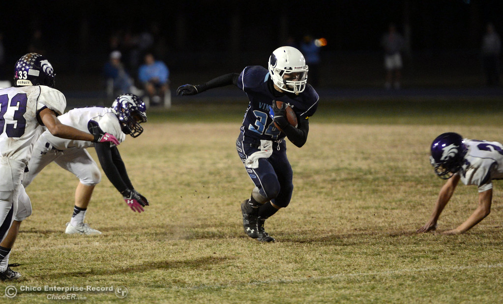 Description of . Pleasant Valley High\'s #34 Cale Crawford (center) rushes a punt return against Shasta High in the fourth quarter of their football game at PVHS Asgard Yard Friday, October 18, 2013 in Chico, Calif.  (Jason Halley/Chico Enterprise-Record)