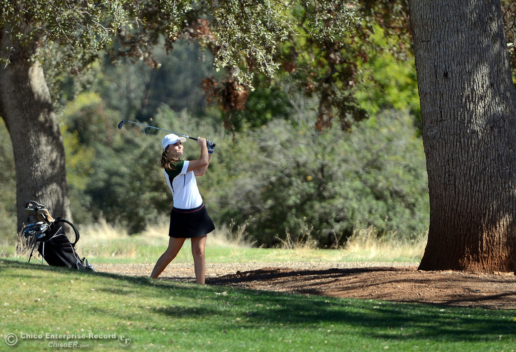Description of . Paradise High Kelsey Kennedy plays in the EAL girls golf match at Bidwell Golf Course Thursday, October 3, 2013, in Chico, Calif.  (Jason Halley/Chico Enterprise-Record)