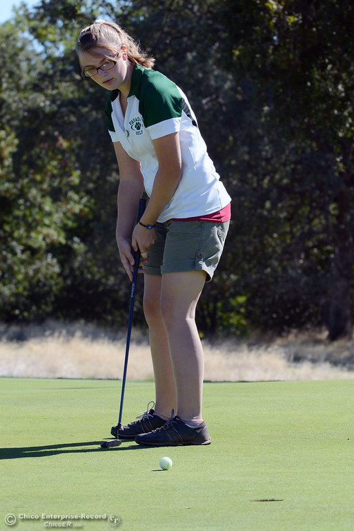 Description of . Paradise High's Samantha Poll plays in the EAL girls golf match at Bidwell Golf Course Thursday, October 3, 2013, in Chico, Calif.  (Jason Halley/Chico Enterprise-Record)