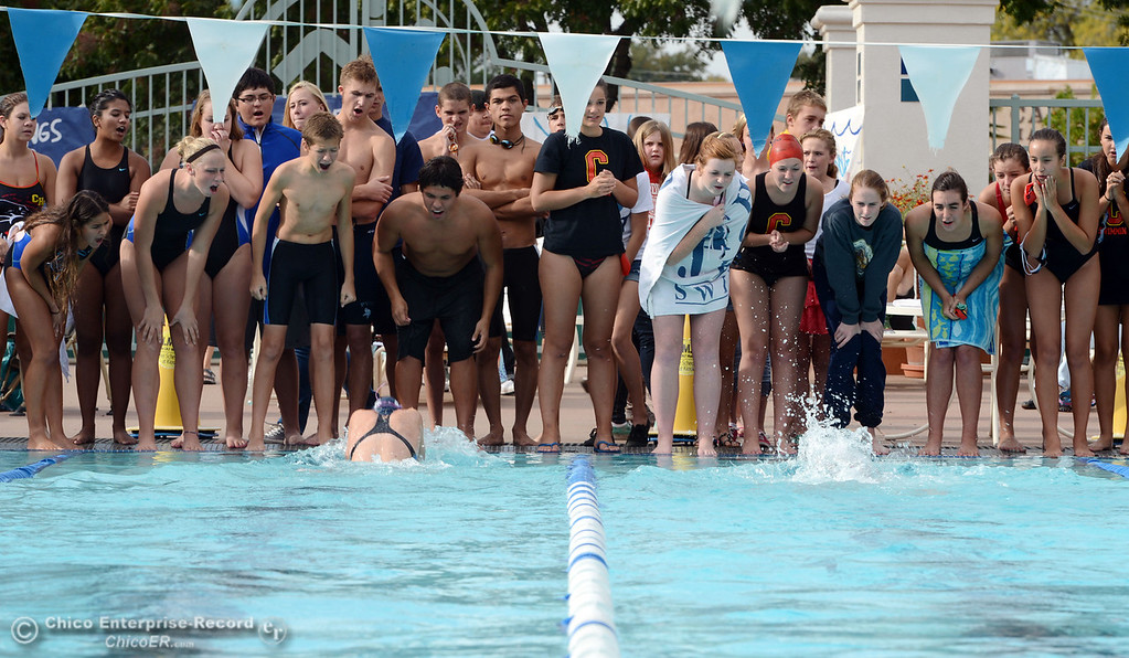 Description of . Fans cheer on Pleasant Valley HIgh's Amanda Jones (left) and Chico High's Cydni Aird (right) in the 200 Medley Relay in their swim meet at InMotion Fitness Wednesday, October 16, 2013 in Chico, Calif.  (Jason Halley/Chico Enterprise-Record)