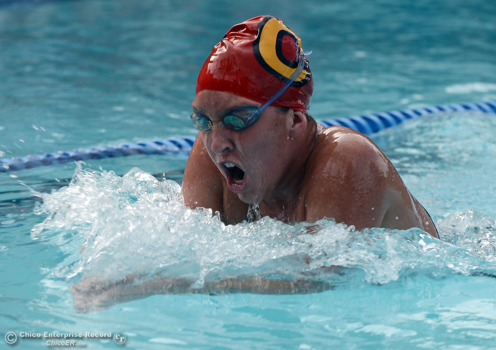 Description of . Chico High's Cydni Aird swims the breast stroke in the 200 IM against Pleasant Valley HIgh in their swim meet at InMotion Fitness Wednesday, October 16, 2013 in Chico, Calif.  (Jason Halley/Chico Enterprise-Record)