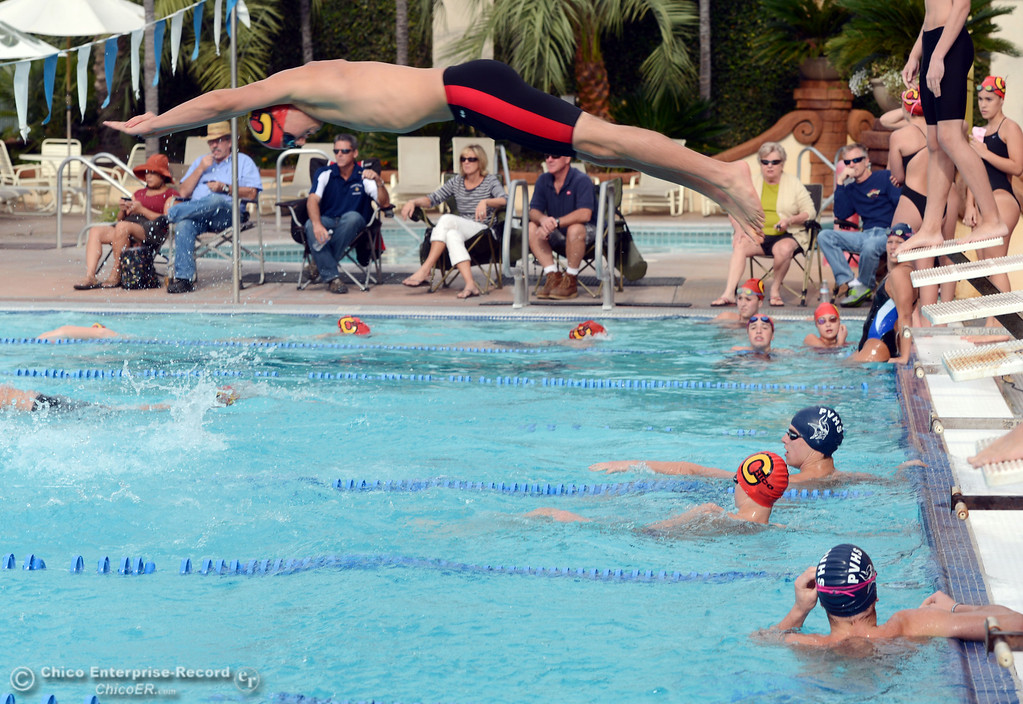. Chico High\'s Spencer Binsfeld (top) makes the exchange in the 200 Medley Relay against Pleasant Valley HIgh in their swim meet at InMotion Fitness Wednesday, October 16, 2013 in Chico, Calif.  (Jason Halley/Chico Enterprise-Record)