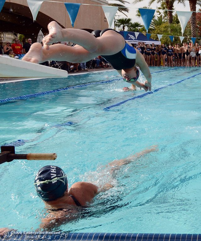 . Pleasant Valley HIgh\'s Amanda Jones (top) makes the exchange over Keely Johnson (bottom) in the 200 Medley Relay against Chico High in their swim meet at InMotion Fitness Wednesday, October 16, 2013 in Chico, Calif.  (Jason Halley/Chico Enterprise-Record)