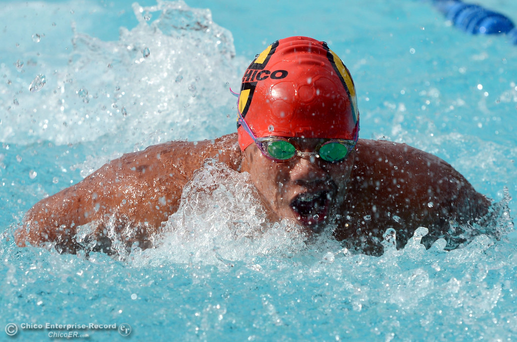 Description of . Chico HIgh\'s Sean Ryan swims the butterfly in the 200 Medley Relay against Pleasant Valley High in their swim meet at InMotion Fitness Wednesday, October 16, 2013 in Chico, Calif.  (Jason Halley/Chico Enterprise-Record)