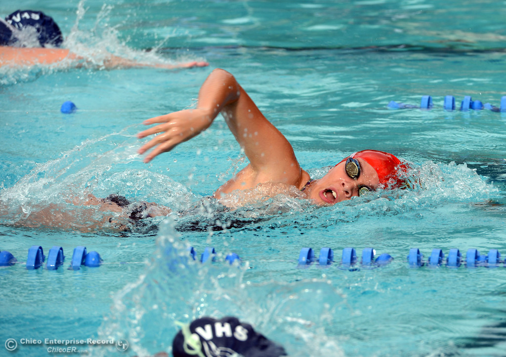 . Chico High Josie Cornwall swims in the 200m freestyle against  Pleasant Valley High in their swim meet at InMotion Fitness Wednesday, October 16, 2013 in Chico, Calif.  (Jason Halley/Chico Enterprise-Record)
