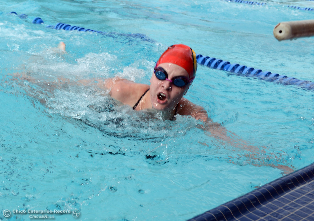 . Chico HIgh\'s Paige Treff finishes the freestyle in the 200 Medley Relay against Pleasant Valley High in their swim meet at InMotion Fitness Wednesday, October 16, 2013 in Chico, Calif.  (Jason Halley/Chico Enterprise-Record)