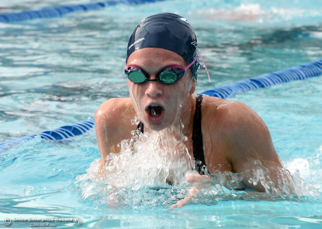 Description of . Pleasant Valley HIgh's Amanda Jones swims the breast stroke in the 200 Medley Relay against Chico High in their swim meet at InMotion Fitness Wednesday, October 16, 2013 in Chico, Calif.  (Jason Halley/Chico Enterprise-Record)