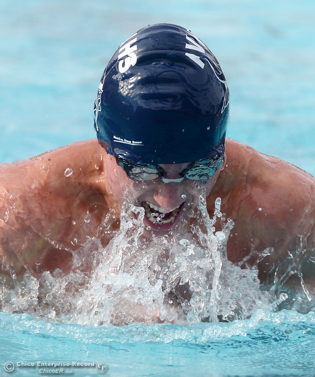 Description of . Pleasant Valley HIgh's Jonny Borg swims the breast stroke in the 200 Medley Relay against Chico High in their swim meet at InMotion Fitness Wednesday, October 16, 2013 in Chico, Calif.  (Jason Halley/Chico Enterprise-Record)