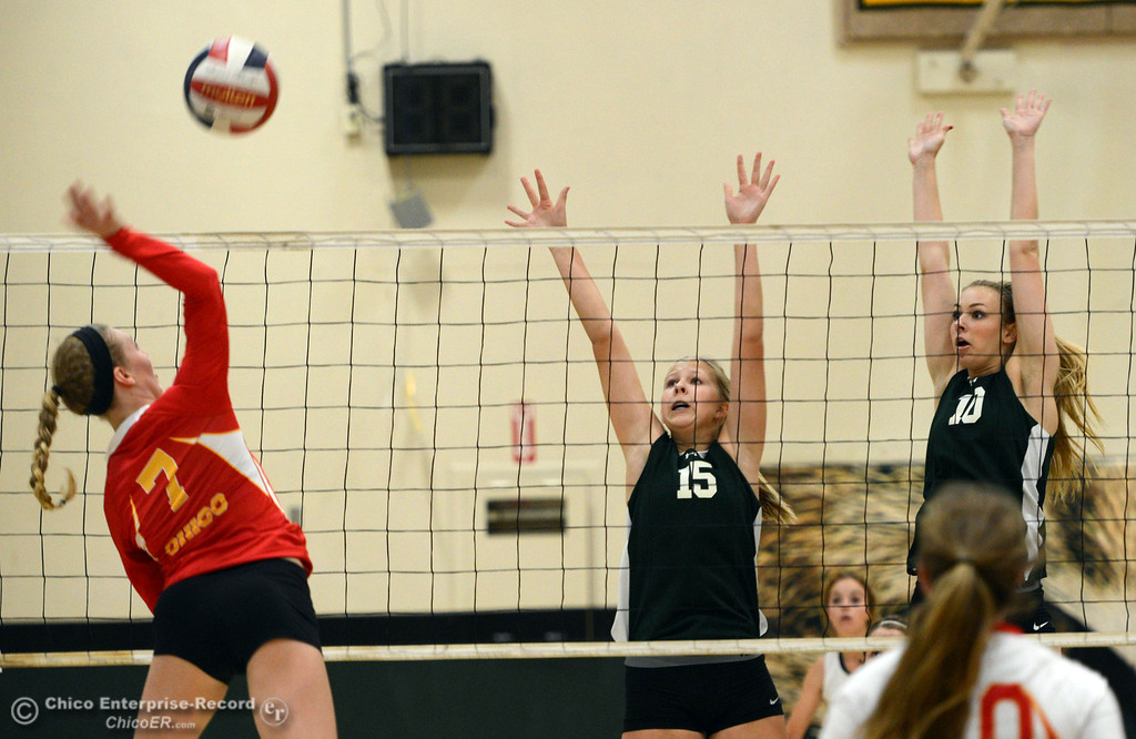 Description of . Chico High's #7 Allysa Barrett (left) against Paradise High's #15 Emilee Heinke (center) and #10 Larissa Knifong (right) in the first game of their girls volleyball match at PHS Thursday, October 10, 2013 in Paradise, Calif.  (Jason Halley/Chico Enterprise-Record)