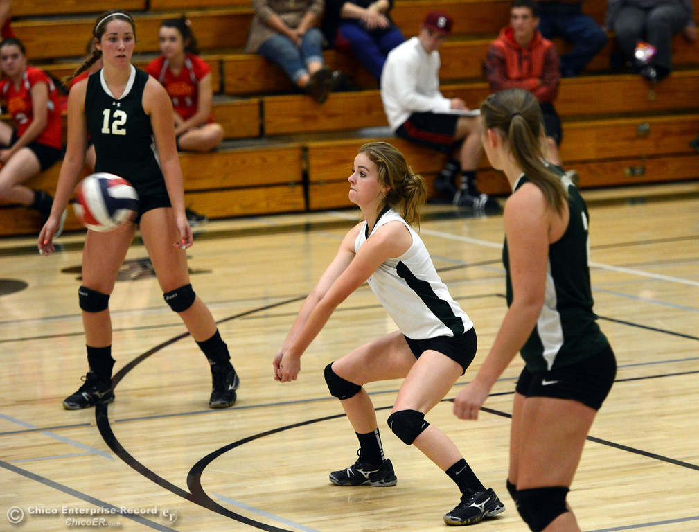 Description of . Chico High against Paradise High's #1 Kayla Grubert (center) takes a dig in the second game of their girls volleyball match at PHS Thursday, October 10, 2013 in Paradise, Calif.  (Jason Halley/Chico Enterprise-Record)