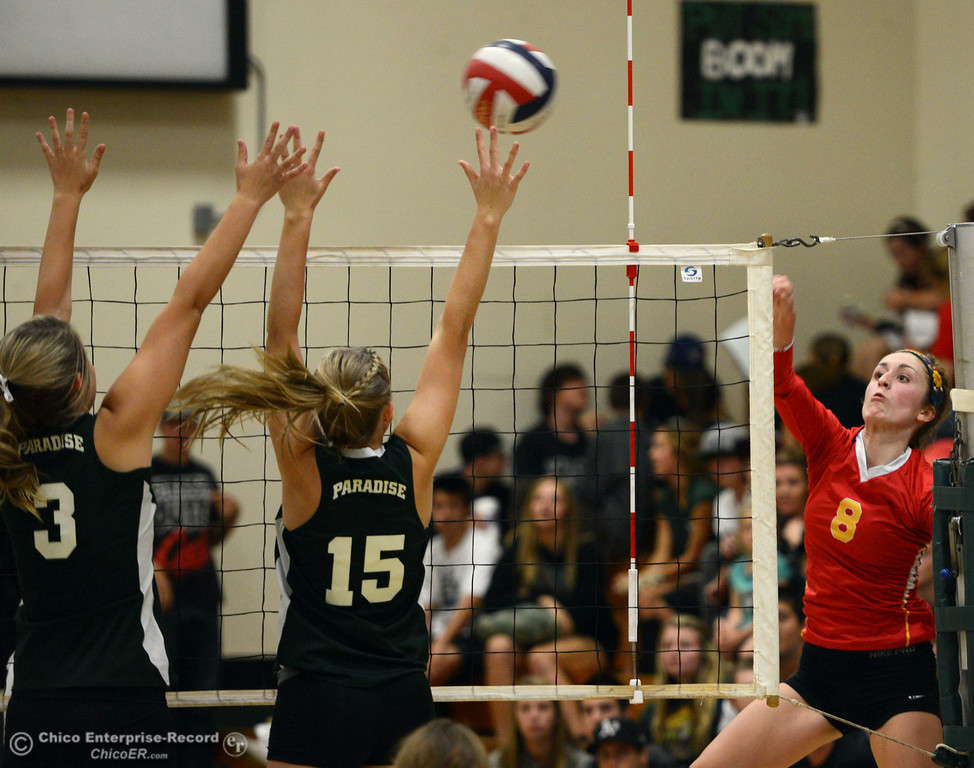 Description of . Chico High's #8 Emma Contreras (right) spikes against Paradise High's #15 Emilee Heinke (center) and #3 Kelsi Earhart (left) in the second game of their girls volleyball match at PHS Thursday, October 10, 2013 in Paradise, Calif.  (Jason Halley/Chico Enterprise-Record)