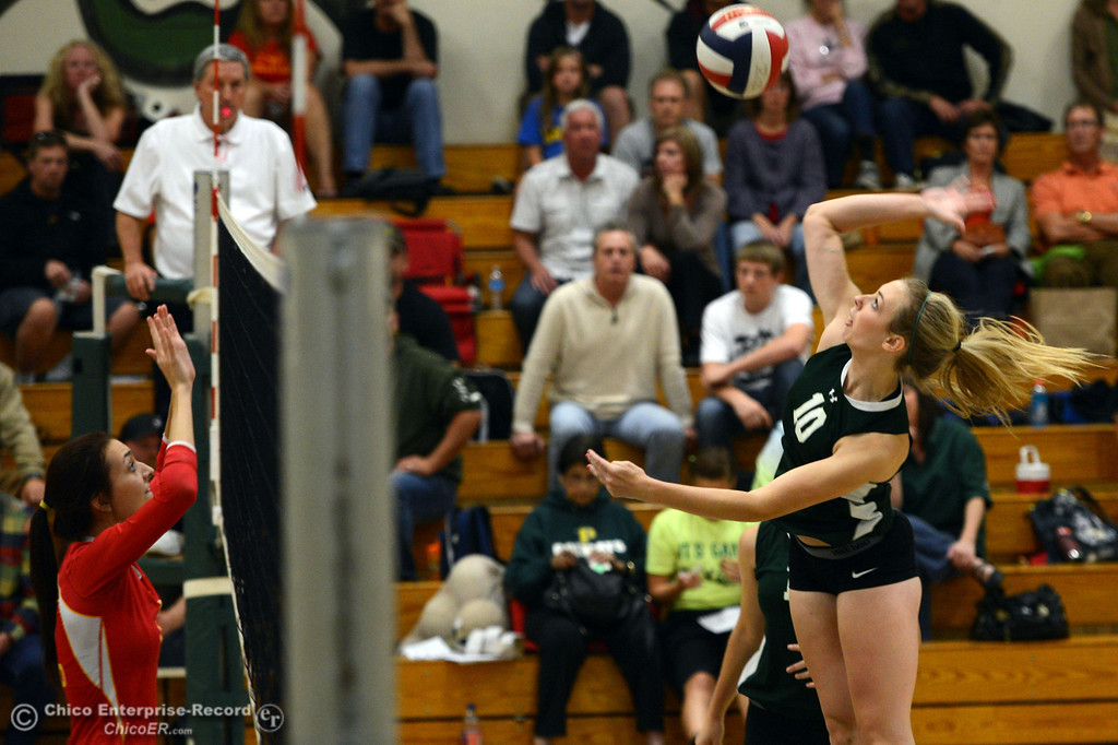 Description of . Paradise High's #10 Larissa Knifong (right) spikes the ball against Chico High in the second game of their girls volleyball match at PHS Thursday, October 10, 2013 in Paradise, Calif.  (Jason Halley/Chico Enterprise-Record)