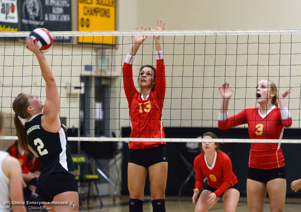 Description of . Paradise High's #2 Bailey Bengson (left) spikes against Chico HIgh's #13 Becca Korte (center) and #3 KC Sicheneder (right) in the second game of their girls volleyball match at PHS Thursday, October 10, 2013 in Paradise, Calif.  (Jason Halley/Chico Enterprise-Record)