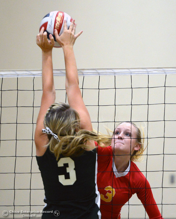 Description of . Paradise High's #3 Kelsi Earhart (bottom) blocks a hit by Chico High's #3 KC Sicheneder (top) in the second game of their girls volleyball match at PHS Thursday, October 10, 2013 in Paradise, Calif.  (Jason Halley/Chico Enterprise-Record)