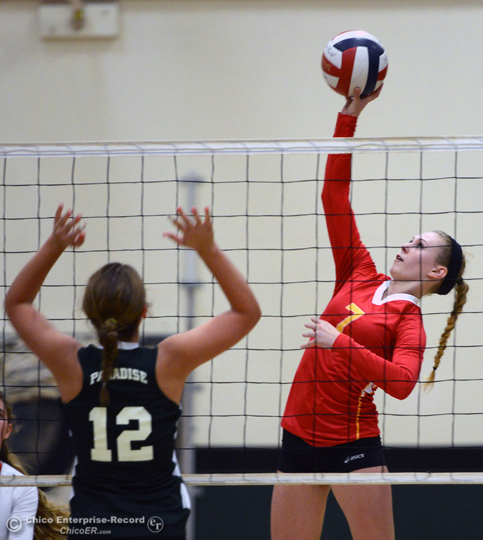 Description of . Chico High's #7 Allysa Barrett (right) spikes against Paradise High's #12 Mariah Mundt (left) in the second game of their girls volleyball match at PHS Thursday, October 10, 2013 in Paradise, Calif.  (Jason Halley/Chico Enterprise-Record)
