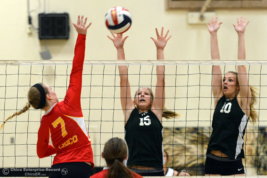 Description of . Chico High\'s #7 Allysa Barrett (left) against Paradise High\'s #15 Emilee Heinke (center) and #10 Larissa Knifong (right) in the first game of their girls volleyball match at PHS Thursday, October 10, 2013 in Paradise, Calif.  (Jason Halley/Chico Enterprise-Record)