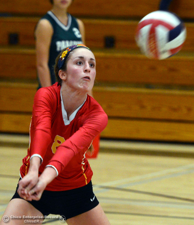 Description of . Chico High's #8 Emma Contreras takes a dig against Paradise High in the second game of their girls volleyball match at PHS Thursday, October 10, 2013 in Paradise, Calif.  (Jason Halley/Chico Enterprise-Record)