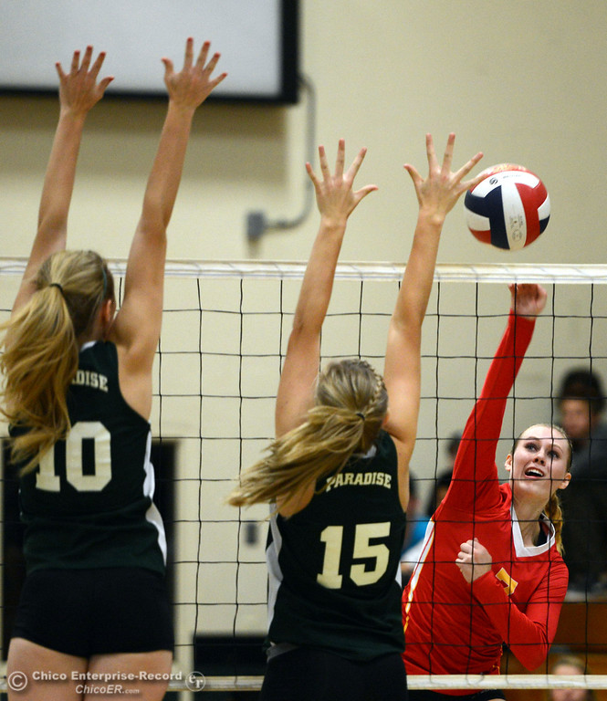 Description of . Chico High's #7 Allysa Barrett (right) spikes the ball against Paradise High's #15 Emilee Heinke (center) and #10 Larissa Knifong (left) in the second game of their girls volleyball match at PHS Thursday, October 10, 2013 in Paradise, Calif.  (Jason Halley/Chico Enterprise-Record)