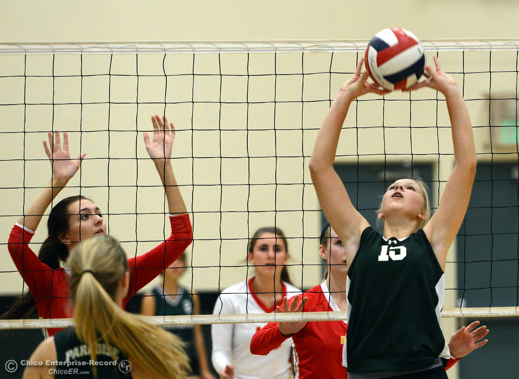 Description of . Paradise High's #15 Emilee Heinke (right) sets the ball in the second game of their girls volleyball match at PHS Thursday, October 10, 2013 in Paradise, Calif.  (Jason Halley/Chico Enterprise-Record)