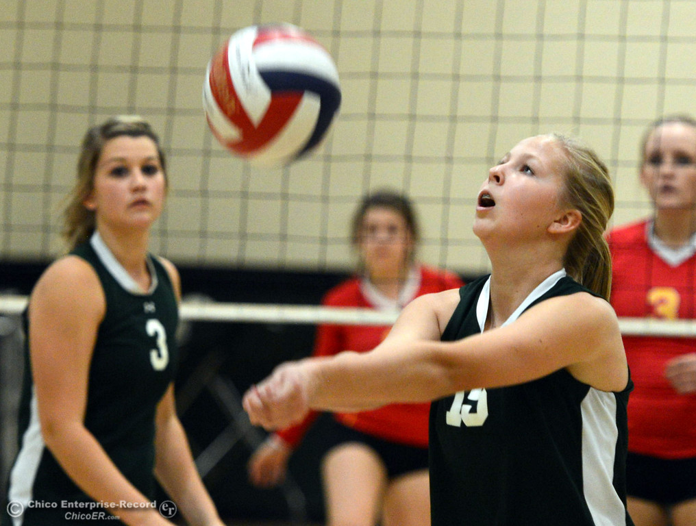 Description of . Chico High against Paradise High's #15 Emilee Heinke (right) in the second game of their girls volleyball match at PHS Thursday, October 10, 2013 in Paradise, Calif.  (Jason Halley/Chico Enterprise-Record)