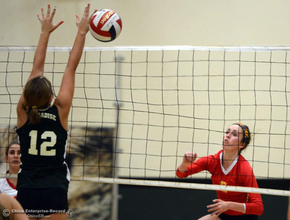 Description of . Chico High\'s #8 Emma Contreras (right) spikes against Paradise High\'s #12 Mariah Mundt (left) in the second game of their girls volleyball match at PHS Thursday, October 10, 2013 in Paradise, Calif.  (Jason Halley/Chico Enterprise-Record)