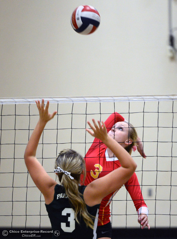 Description of . Chico High\'s #3 KC Sicheneder (top) spikes against Paradise High\'s #3 Kelsi Earhart (bottom) in the second game of their girls volleyball match at PHS Thursday, October 10, 2013 in Paradise, Calif.  (Jason Halley/Chico Enterprise-Record)