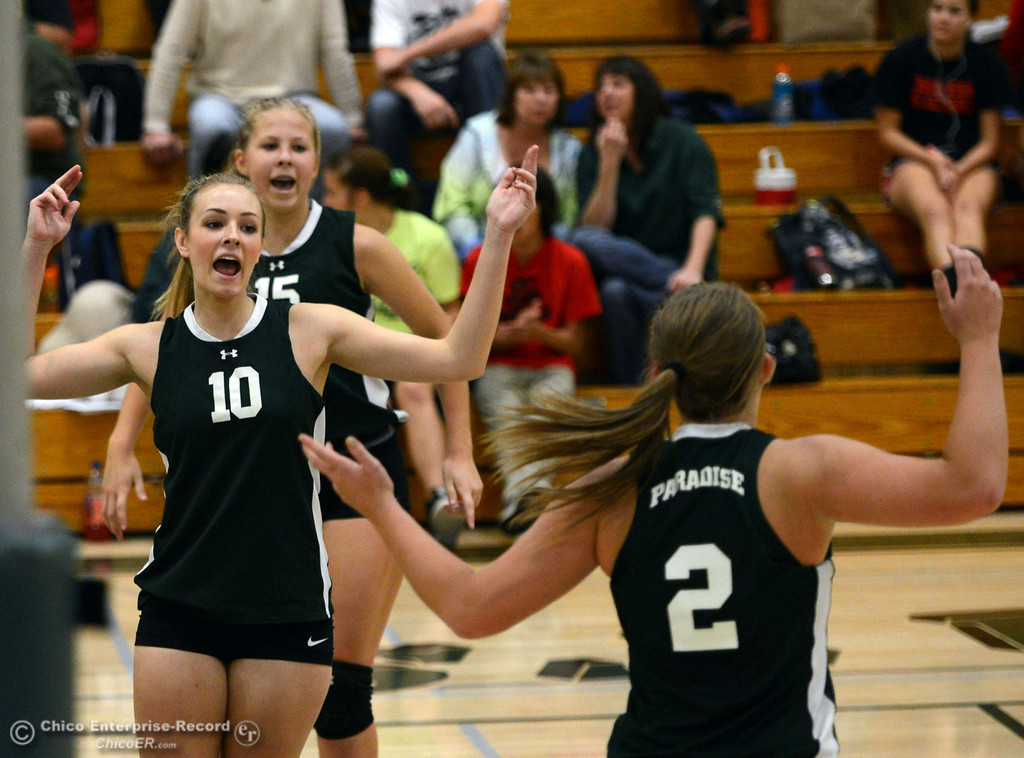 Description of . Paradise High's #15 Emilee Heinke, #10 Larissa Knifong and #2 Bailey Bengson (front to back) react to scoring against Chico High in the second game of their girls volleyball match at PHS Thursday, October 10, 2013 in Paradise, Calif.  (Jason Halley/Chico Enterprise-Record)