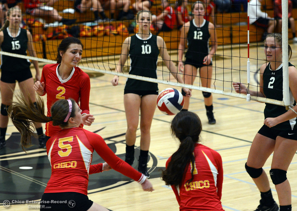 Description of . Chico High\'s #2 Sydney Gaskey, #5 Amanda Manning, and #1 Cia Seibert (left to right) are unable to make a save against Paradise High in the second game of their girls volleyball match at PHS Thursday, October 10, 2013 in Paradise, Calif.  (Jason Halley/Chico Enterprise-Record)